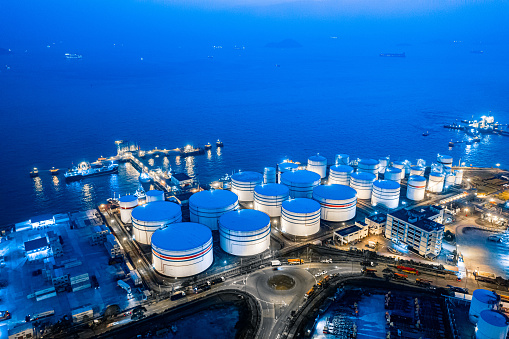 Diesel Fuel「Storage tank of liquid chemical and petrochemical product tank, Aerial view at night. Hong Kong」:スマホ壁紙(8)