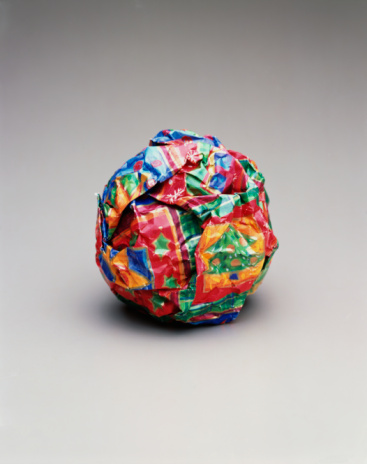 Christmas Paper「Christmas wrapping paper in ball, close-up」:スマホ壁紙(15)