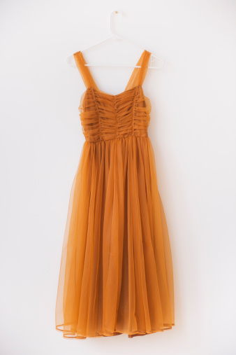 Orange Color「Shiffon dress on hanger against white wall」:スマホ壁紙(19)