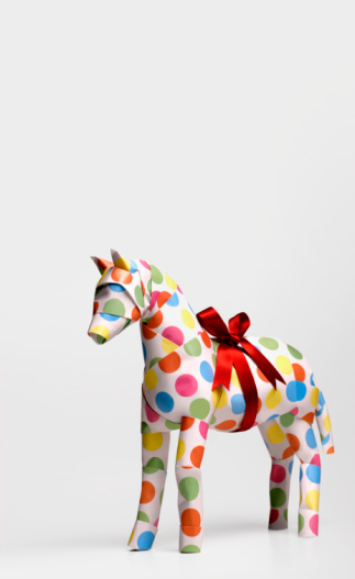 Horse「Gift horse with ribbon against white background, close-up」:スマホ壁紙(0)