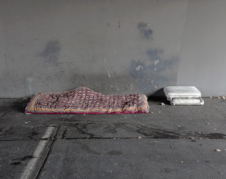 Homelessness「homeless person's bed and pillows under bridge」:スマホ壁紙(4)