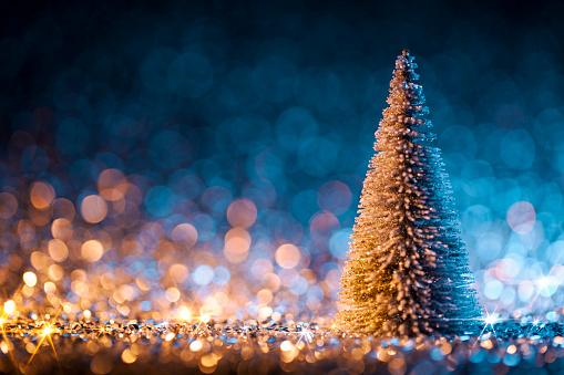 Christmas Decoration「Christmas tree on defocused lights. Decorations Blue Gold」:スマホ壁紙(15)