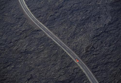 Volcanic Landscape「Car on road in lava field, overhead view (Digital Composite)」:スマホ壁紙(11)