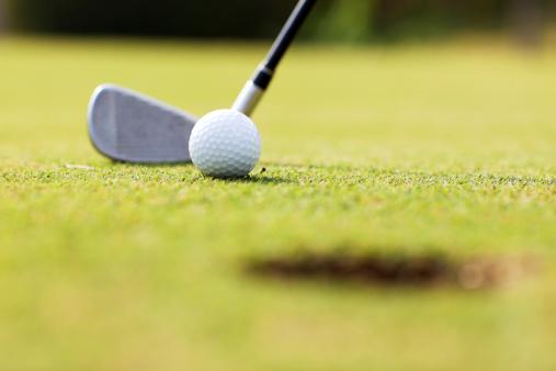 Golf Ball「Golf ball and stick on the field.」:スマホ壁紙(9)