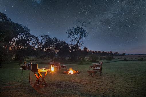 Astronomy「A safari camp at night under starry sky」:スマホ壁紙(1)
