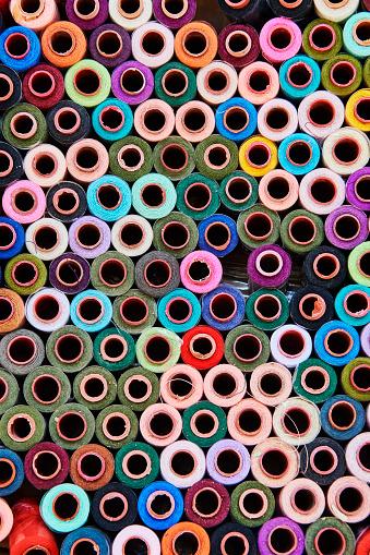Sewing「spool of sewing thread in Bukhara market」:スマホ壁紙(6)