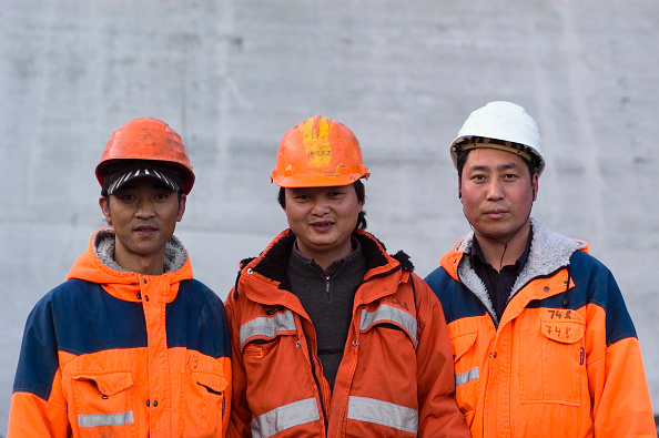Hardhat「There are over 1.500 workers coming from many countries (particularly China, Portugal, Italy, Pakistan), engaged in the construction of the Karahnjukar, the largest dam in Europe. The work camp is one of the largest populated areas of Iceland.」:写真・画像(12)[壁紙.com]