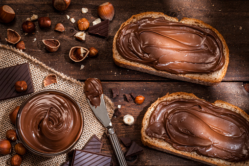 Nut - Food「Chocolate and hazelnut spread on bread slices shot on rustic wooden table」:スマホ壁紙(16)