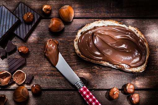 Nut - Food「Chocolate and hazelnut spread on bread slice shot on rustic wooden table」:スマホ壁紙(15)