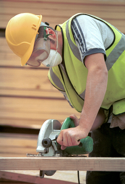 Hardhat「Carpentry and Joinery. Operating a circular portable saw.」:写真・画像(9)[壁紙.com]