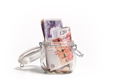 Budget「British pound notes in savings jar」:スマホ壁紙(17)