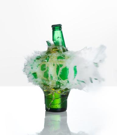 Destruction「A beer bottle exploding on  a white background」:スマホ壁紙(9)