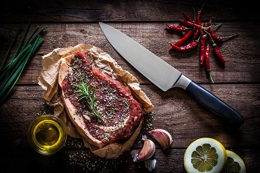 Beef「Raw beef steak on rustic wooden table」:スマホ壁紙(1)