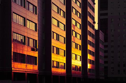 Twilight「Modern color multi-stored building. Sunlight shining at glass wall」:スマホ壁紙(7)