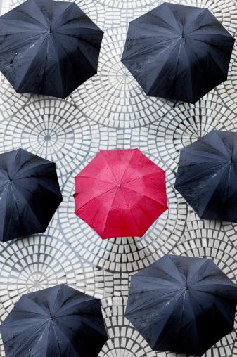 Midsection「One red umbrella encircled by black umbrellas」:スマホ壁紙(17)