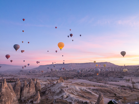 Turkey - Middle East「Hot air balloons flying in red and rose valley in Goreme in Cappadocia in Turkey」:スマホ壁紙(14)