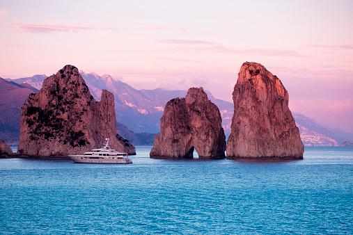 Tyrrhenian Sea「Luxury yacht near Faraglioni Rocks at sunset」:スマホ壁紙(0)