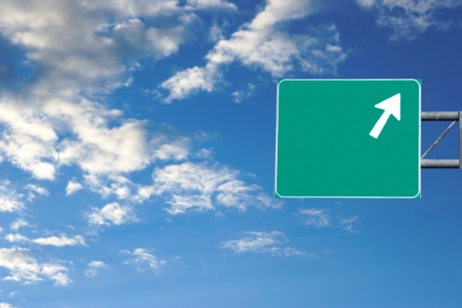 Traffic Arrow Sign「Highway sign against blue sky with clouds (Digital Composite)」:スマホ壁紙(5)