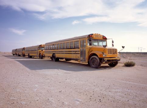 State School「Discarded school busses parked in desert.」:スマホ壁紙(5)