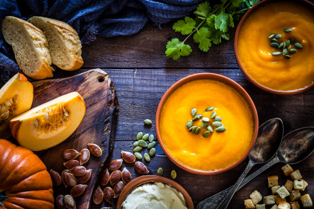 Pumpkin soup with ingredients on rustic wooden table:スマホ壁紙(壁紙.com)