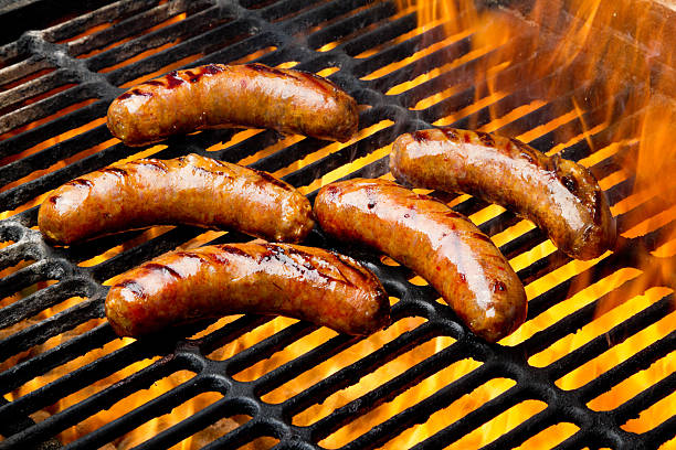 Bratwurst or Hot Dogs on Grill with Flames:スマホ壁紙(壁紙.com)