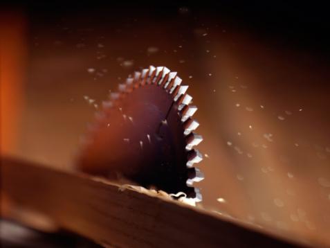 Carpentry「A saw blade cutting through wood」:スマホ壁紙(12)