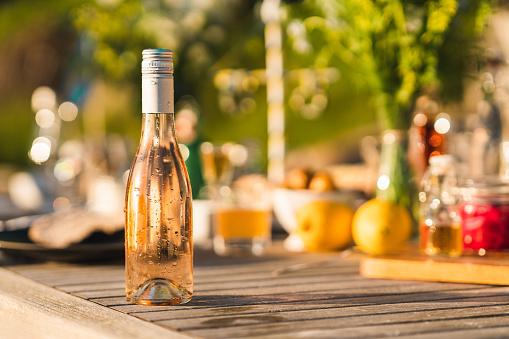 Swedish Culture「Bottle of cold rose wine on midsummer dinner table」:スマホ壁紙(15)