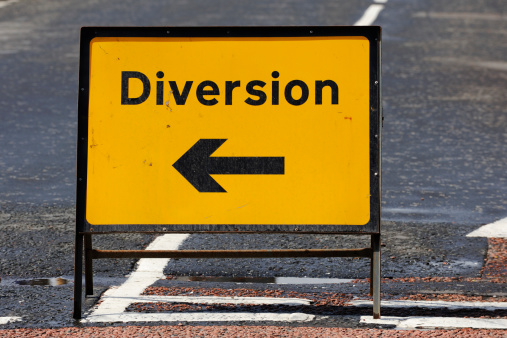 Delayed Sign「British diversion road sign on a street in Scotland」:スマホ壁紙(6)