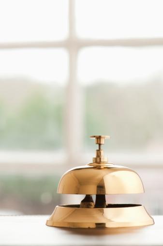 Motel「Service bell on desk beside window with copy space」:スマホ壁紙(14)