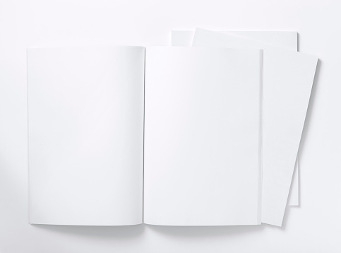 Writing「Blank white magazine lying open on a white table」:スマホ壁紙(8)