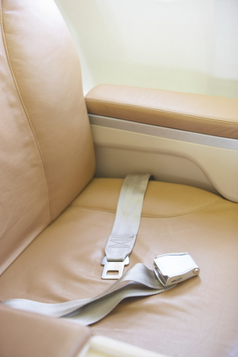 Passenger Cabin「Seat belt across empty seat on airplane, elevated view」:スマホ壁紙(12)