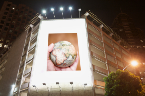 Hand「billboard display at night showing man holding glo」:スマホ壁紙(18)