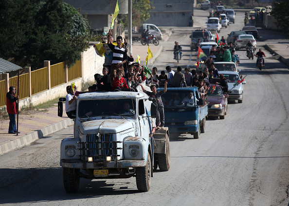 John Moore「Yazidi Refugees In Syria Celebrate Liberation Of Sinjar From ISIL」:写真・画像(18)[壁紙.com]