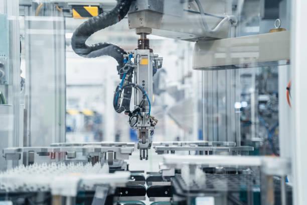 Arm of assembly robot functioning inside modern factory, Stuttgart, Germany:スマホ壁紙(壁紙.com)