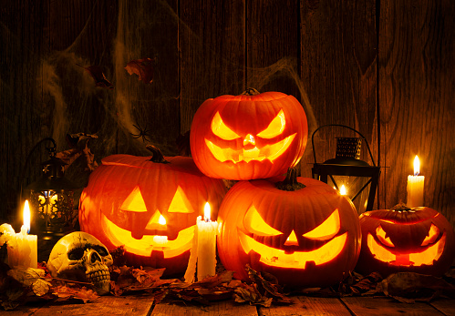 Halloween ghost「Halloween Jack-o-Lantern Pumpkins on rustic wooden background」:スマホ壁紙(12)