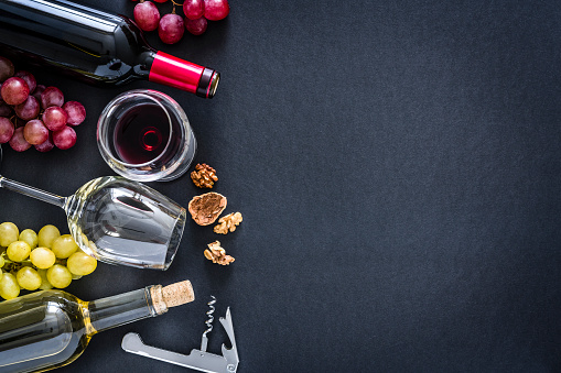 Alcohol - Drink「Wines background: red, rosé and white wines on black background with copy space」:スマホ壁紙(1)