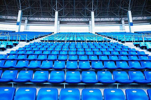 Stadium「Empty blue arena seats with numbers in stadium」:スマホ壁紙(3)