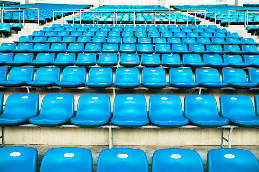 Sports Team「Empty blue arena seats with numbers in a stadium」:スマホ壁紙(17)