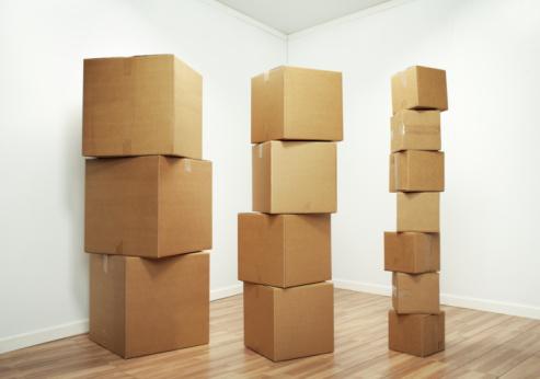 Beginnings「Stacks of cardboard boxes in room」:スマホ壁紙(15)